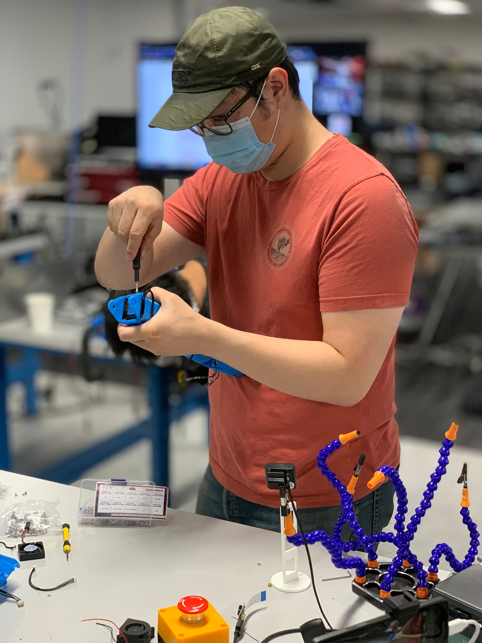 Fall CoLab student Logan assembling Reachy's arm in the Lab at Circuit Launch